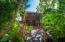 Lush tropical gardens surround the home