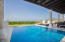 The pool offers stunning ocean views and is partial covered