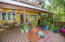 As you enter the home there is a spacious outdoor living space surrounded by lush tropical gardens