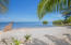 White sand beaches, perfect for swimming, snorkeling and kayaking. The dock is not included in the sale of this property