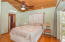 The second master bedroom is located on the second floor and has access to a private deck that over looks West Bay and