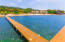 The community dock in Lawson Rock is ideal for snorkeling, swimming and taking in the sunset.