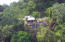 Rear of home from drone Jungle view