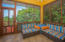 The open aired deck off the dining room leads to a screened in porch