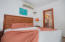 Room 102 - This pool side room features a King bed and private bathroom