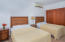 Room 205 - This suite offers 2 Queen size beds and a King bed in an adjoining roomin addition to a private bathroom and ocean views from the patio.