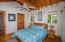 The second floor master bedroom has access to a private deck and ensuite bathroom