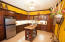 The open concept kitchen is fully equipped