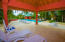 The pool area has a covered area ideal for gathering or taking in the shade.