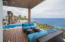 Covered outdoor living area allows you to enjoy the year round tradewinds