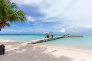 The stunning white sandy beaches at Infinity Bay and the dock.