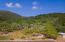 This 6 acre parcel spans from the 200 feet of water frontage to up the mountain
