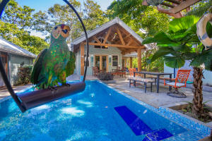 includes a stunning pool, gardens and access to the Guest House