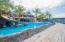 Take a stroll on the boardwalk or take a dip in the pool at Caribe Tesoro