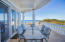The outdoor dining area offers a picturesque setting and 180 degree ocean views