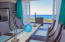 Enjoy panoramic ocean views as you dine in the comfort of the air conditioned living space.