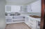The kitchen includes an additional pantry for all your small appliances and cookware