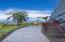 Manicured gardens and walk ways surround the home