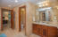 Spacious master bathroom has double vanities, shower and bath tub.