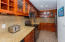 Granite counter tops and mahogany cabinets in the kitchen