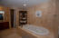 A spa like soaker tub is in the master bathroom