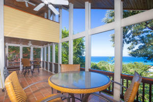The outdoor living area off the living and 1st floor master offer stunning ocean views