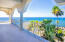 Enjoy the Caribbean Breeze as you entertain while overlooking the Caribbean Sea.