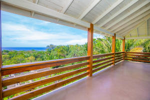 Enjoy clear ocean views from the covered patio on the second floor.