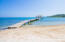 The beach at Palmetto Bay includes a dock, which is idea for swimming, snorkeling and taking in the sunset