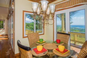 Dining area over looks the patio and offers ocean views.