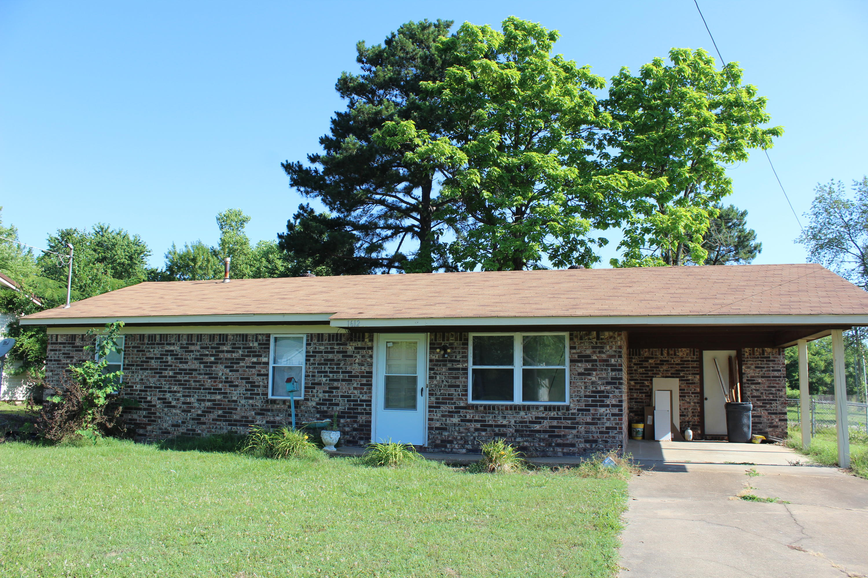 Large photo 1 of home for sale at 1612 Gibson Street, Ozark, AR