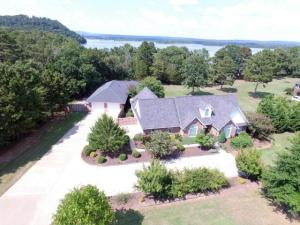 Your family will enjoy the convenience of this home.  Complete with it's own PRIVATE boat dock with a lift on Lake Dardanelle's Piney Bay! This wonderful custom built, energy efficient home includes a HUGE 30x30 detached double garage and workshop/Mother in Law quarters. Enjoy the wonderful scenes of nature from the sunroom or the oversized deck! This one is definitely better viewed in person. Call  today and schedule a showing!