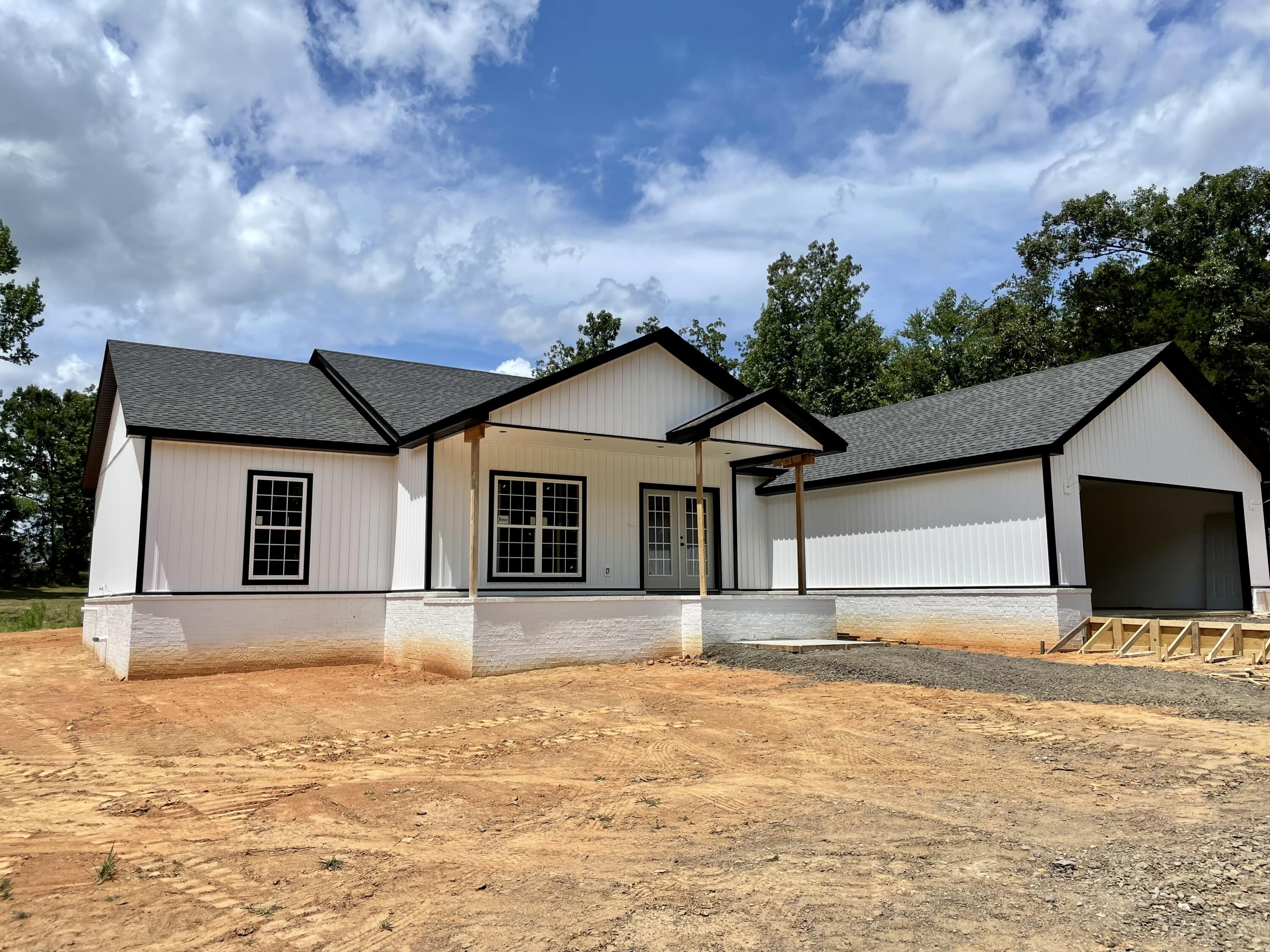 Immaculate Brand New Construction home on 2.47 acres outside Russellville city limits. This 2600 sq ft home features 4 Bedrooms 2.5 bathrooms, and open concept living, kitchen, and dining areas. With vaulted ceilings and 9 ft ceilings this home seamlessly creates a large airy feel, with lots of natural sunlight throughout. Luxury features include Granite counters, wood floors, and stainless steel appliances. Lots of builtins throughout home, with a large utility closet, walk in pantry, and 2 car garage. Master bedroom contains Tray ceilings, walk in tile shower, freestanding tub, and walk in closet. The additional three bedrooms create a split floor plan layout perfect for family style living. Outside features covered front/back porches, level lot surrounded by trees for privacy, and pond.