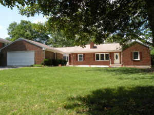 Huge brick ranch will full finished basement, added covered back porch and 2 car garage.
