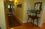 THIS IS THE VIEW OF THE FOYER AND HALL FROM THE OPEN LIVING ROOM AREA.