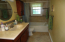 THE MASTER BATH HAS BEEN COMPLETELY REMODELED WITH NEW CABINETS, COUNTER, TILE WORK ON FLOOR AND TUB SURROUND.