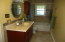 ANOTHER VIEW OF THE MASTER BATHROOM. THE LAUNDRY AREA WAS ADDED IN A CLOSET IN THE BATHROOM TO BRING IT UP ON THE ENTRY LEVEL RATHER THAN THE BASEMENT. NO MORE LUGGING LAUNDRY UP & DOWN STAIRS!