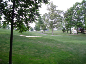 Beautiful Wooded Lot on Golf Course. Walking Distance to Club