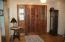 Foyer with hand-carved solid wood door