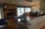 Open Floor Plan. Great room and dining area open onto lakeside deck