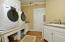 Elevated washer and dryer. Granite counter tops.