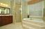 Master Bathroom with Glass Block Shower, Double Vanities and water closet