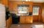 Kitchen with appliances to convey