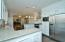 Quality Lighting & plumbing updates and extra floor space for additional dining or furniture placement .