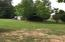 2.84 acres with 3 storage sheds and 1 tiny home which is personal property Fleetwood Home Wingate Model 2662