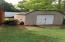 1 of the 3 storage sheds that convey with the land