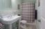 Hall Full Bath with large Vanity and tile floor