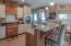 Spacious Kitchen with Glazed Cabinets and Granite Counters