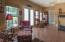 Sunroom with lots of windows is light and bright