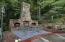 Natural stone Fireplace/grill area off the pool